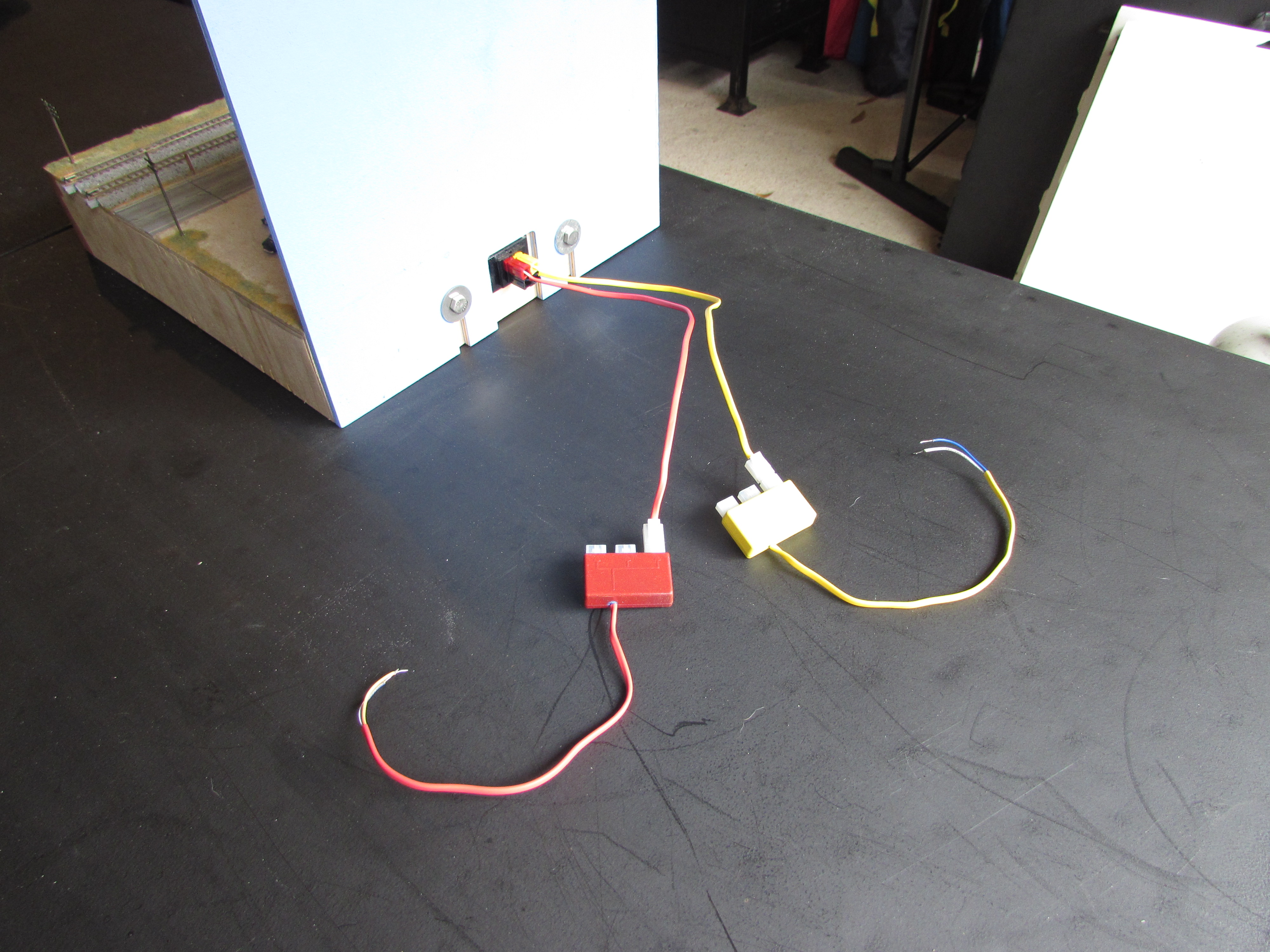 Swarmtrak Module Wiring Practices Anderson Power Poles T Trak Wiki Electrical Inside Walls We Store These Pigtails With Each Powered By The Use Of Adhesive Clips On Wall This Keeps Pigtail Out Sight